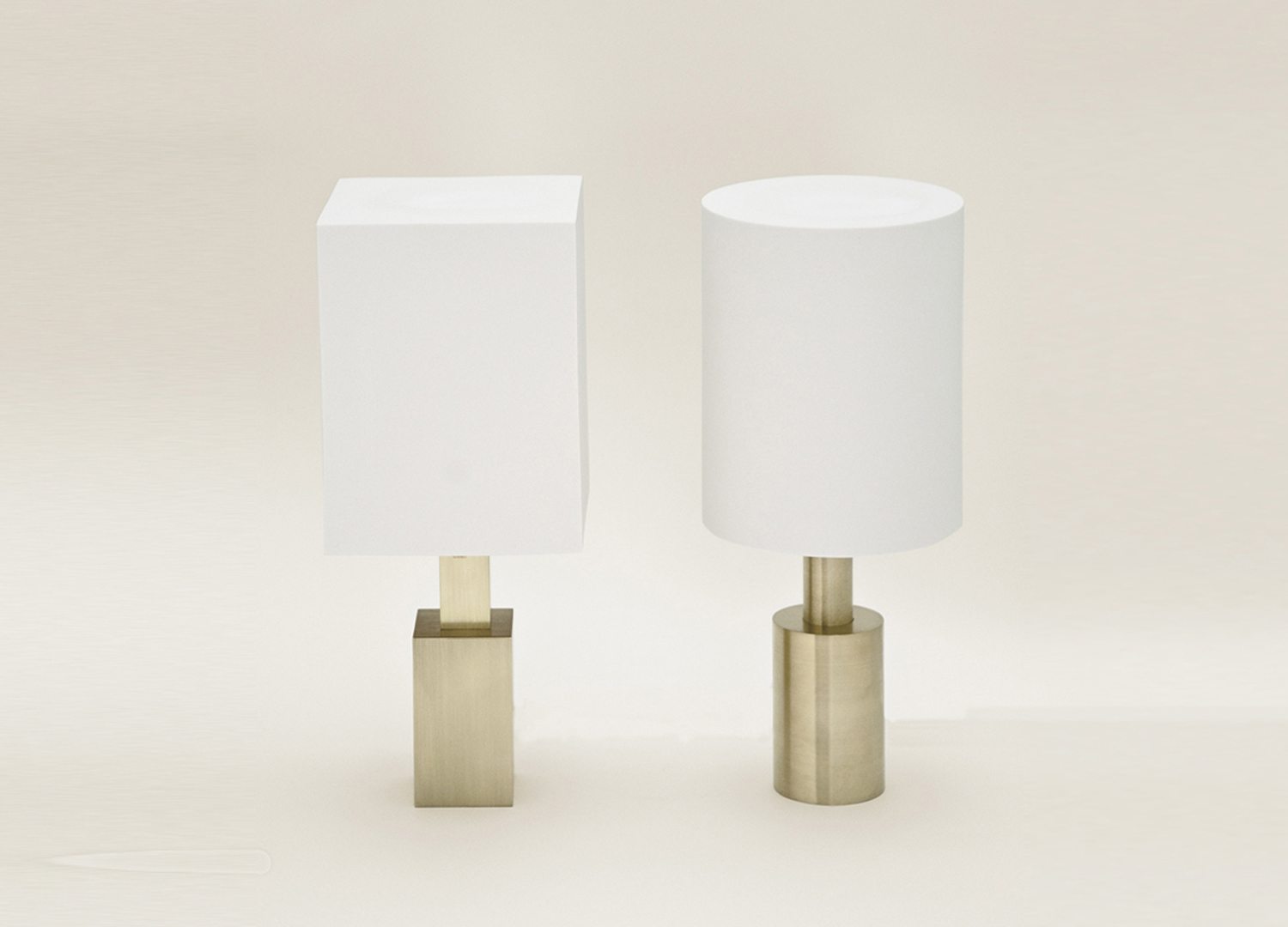 BRASS & PORCELAIN TABLE LAMPS - Translucent porcelain shades on solid brass bases, these lamps elevate basic geometric forms with refined materials and craft. The translucent porcelain gives a soft, warm glow. The circle and square make a mismatched yet elegant pair.Sizes: Rectangle: 16cm L x 16cm W x 26cm HCylinder: 16cm diameter x 26cm HAvailable by special orderphoto by David Trautrimas
