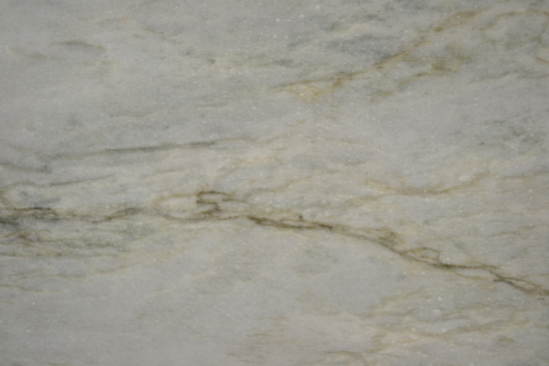 Quartzite is a very hard metamorphic rock that originated as sandstone.  Through a process of high heating and pressurization sandstone is transformed into Quartzite, an extremely strong and durable natural stone.