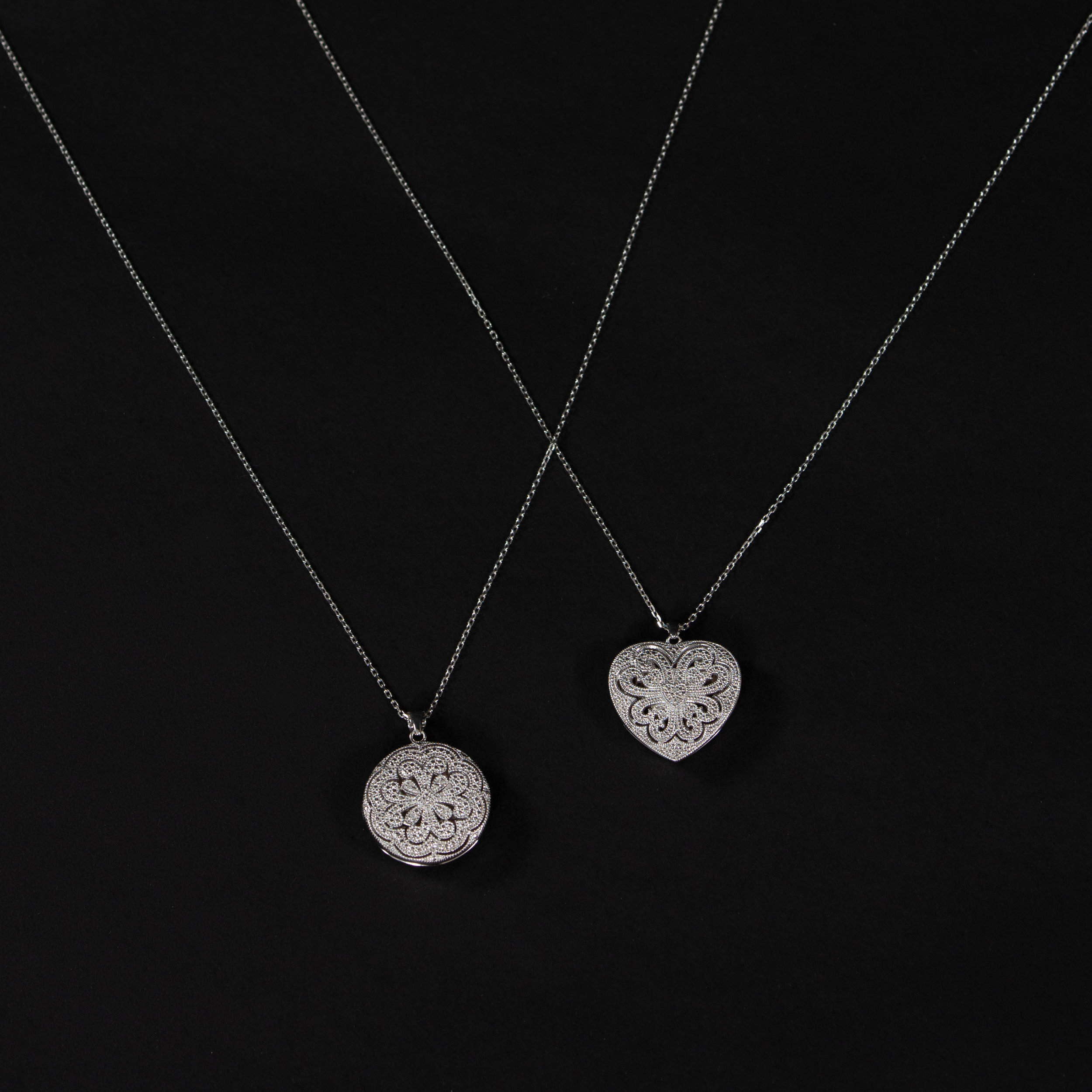 100 special june19 - Heart or Circle Shaped Sterling Silver Locket with intricate cutout.jpg