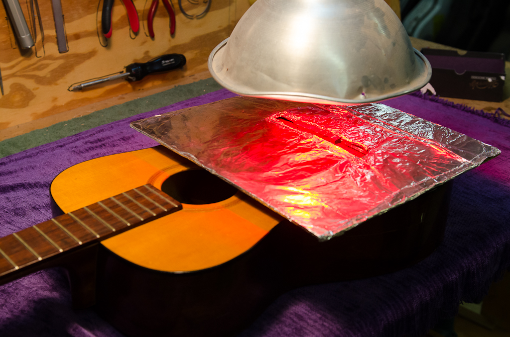 Infrared heat lamp to release the remaining glue bond