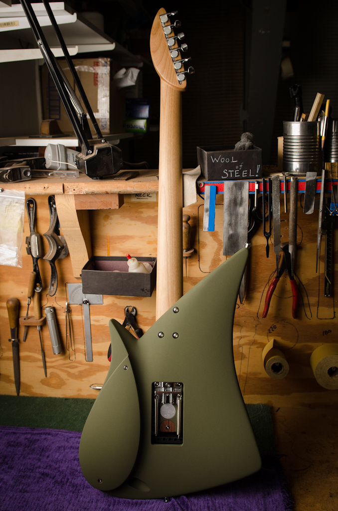 The guitar is strung up and the neck restored to new condition.