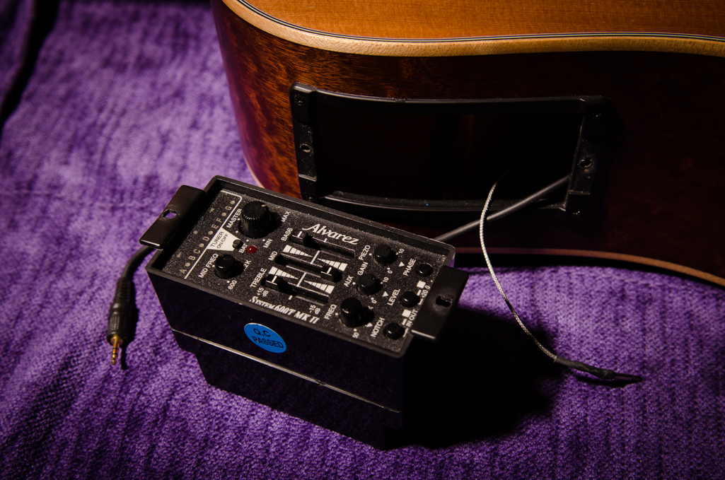 The pickup plugs into the side-mounted preamp.