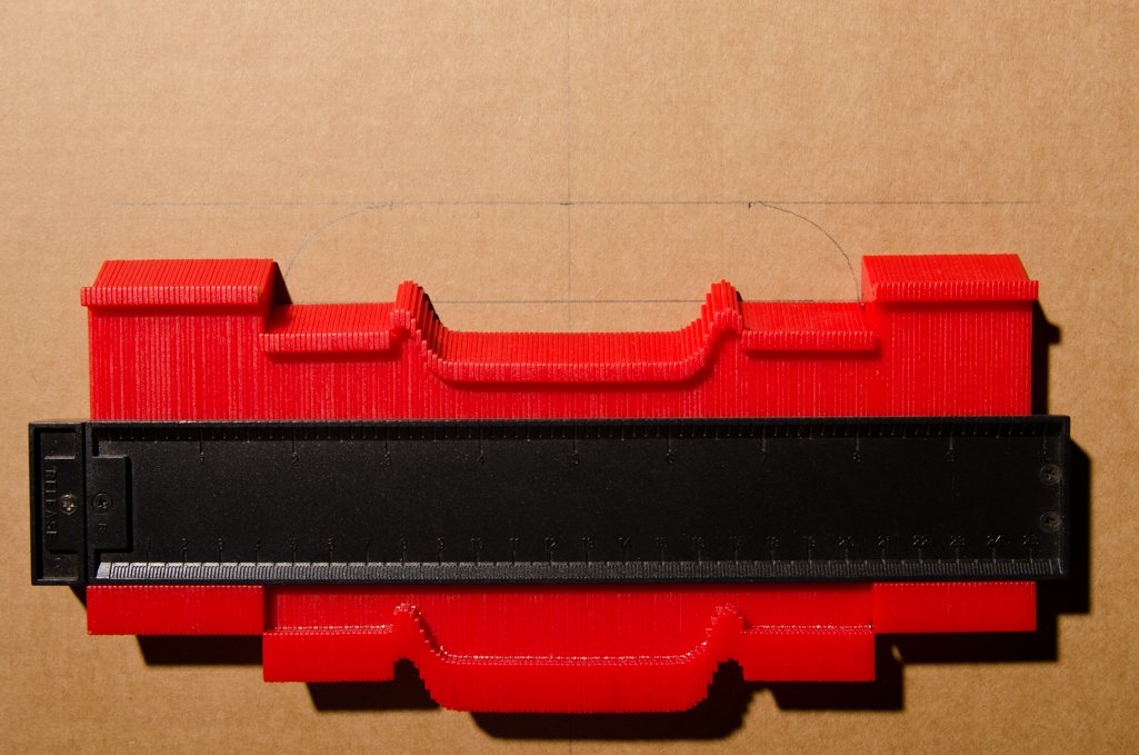 The bridge dimensions are transferred to a piece of corrugated cardboard.