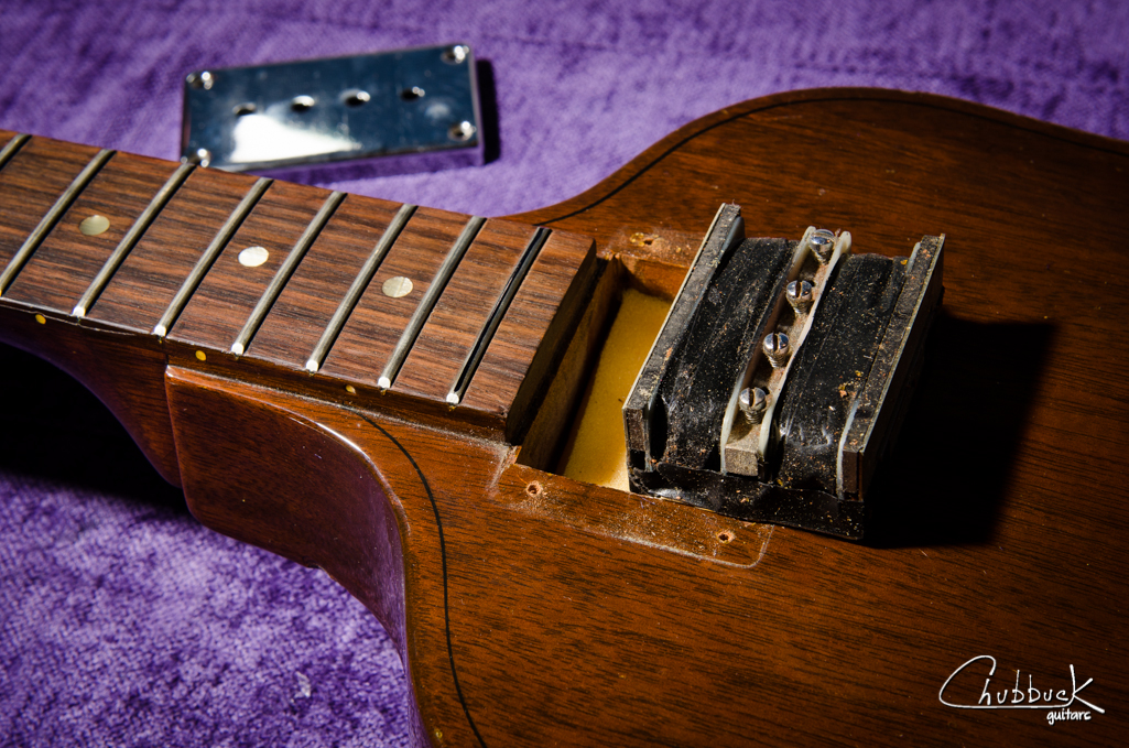"""The infamous Gibson """"mudbucker"""". This pickup was rattling inside the cover, so foam was added underneath to make up for the compressed original foam."""
