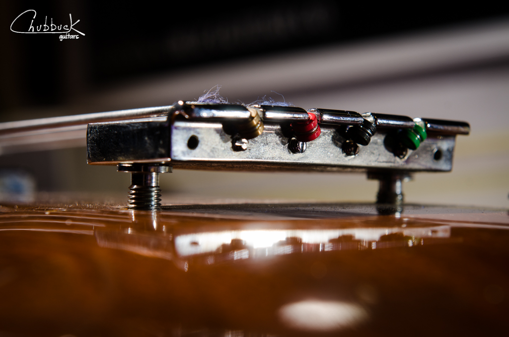 Just below the string ball ends is the saddle intonation adjustments.