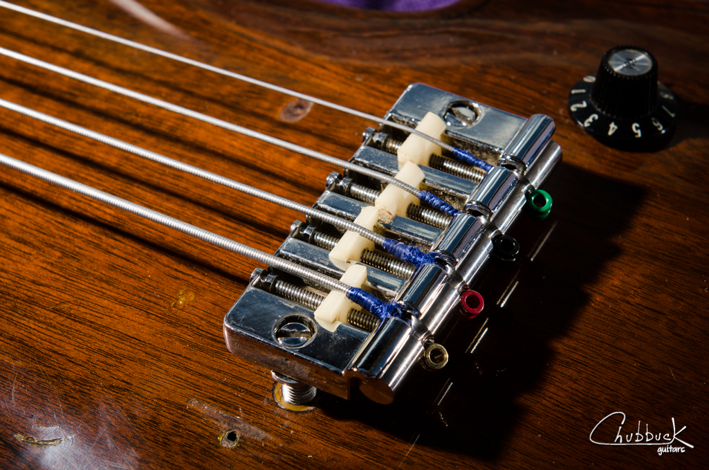 The bridge with the MOD-BAR installed. No modifications to the original bridge are required and the bar is held on by string tension alone. Very slick!