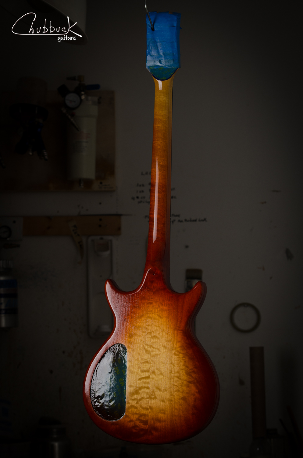 The headstock's face, rear and sides were left with the original finish and the new nitro finish is blended into these transition points.