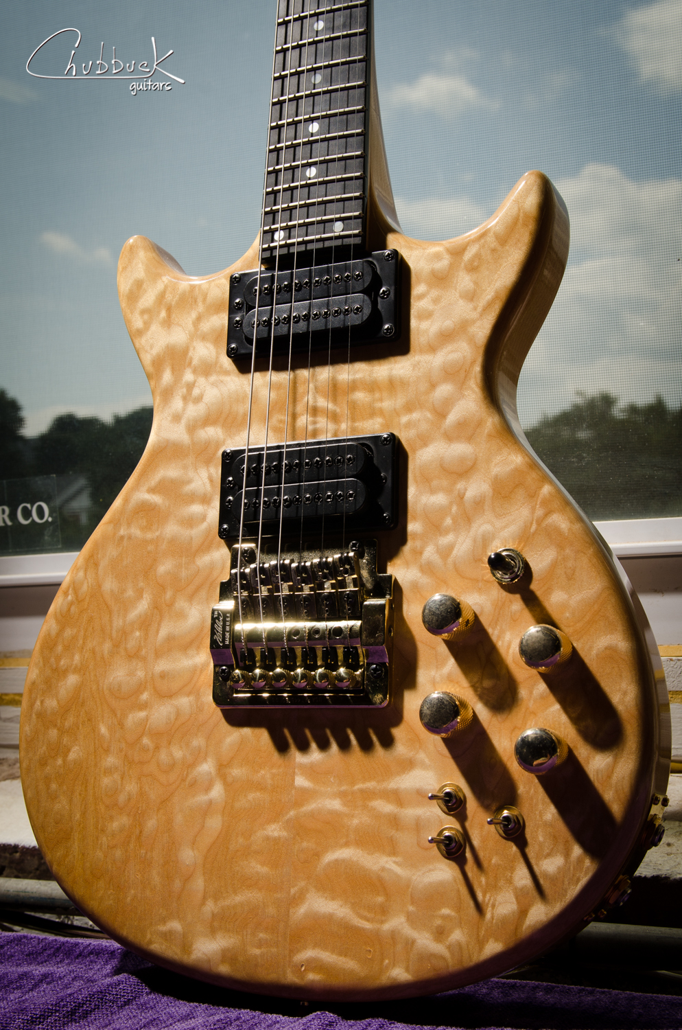 1987 Carvin DC-150 with a clear finish.