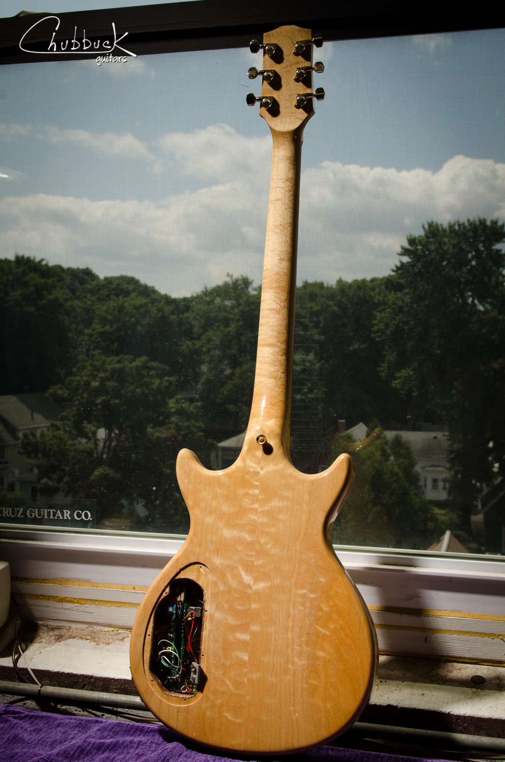 Beautiful figured all-maple construction finished in a surprisingly thin  polyurethane  clear finish.