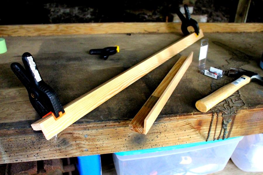 clamping wood together to create a studio art shelf