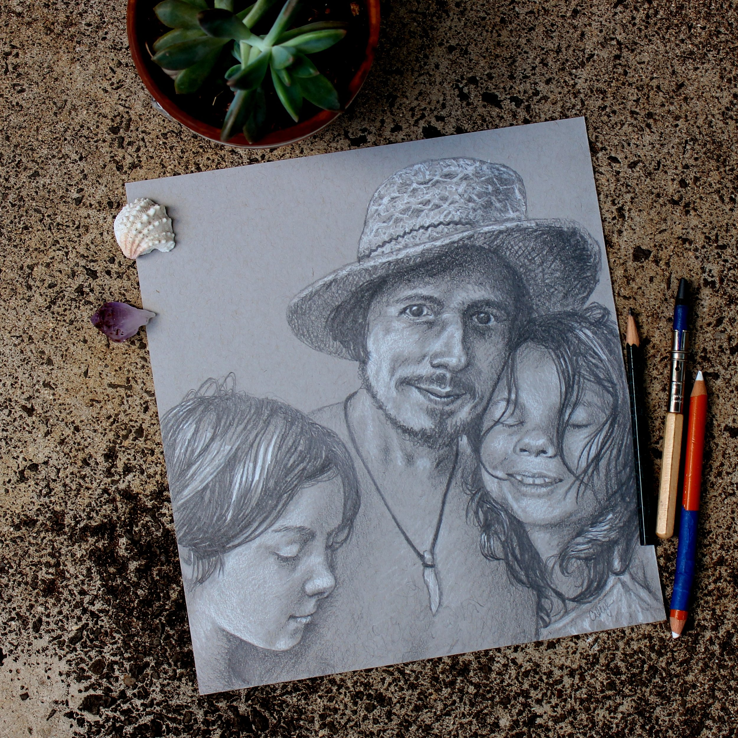 pencil portrait drawing of a family