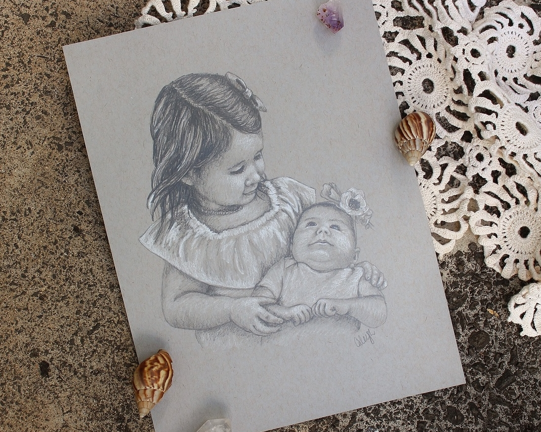 portrait of a little girl holding baby sister