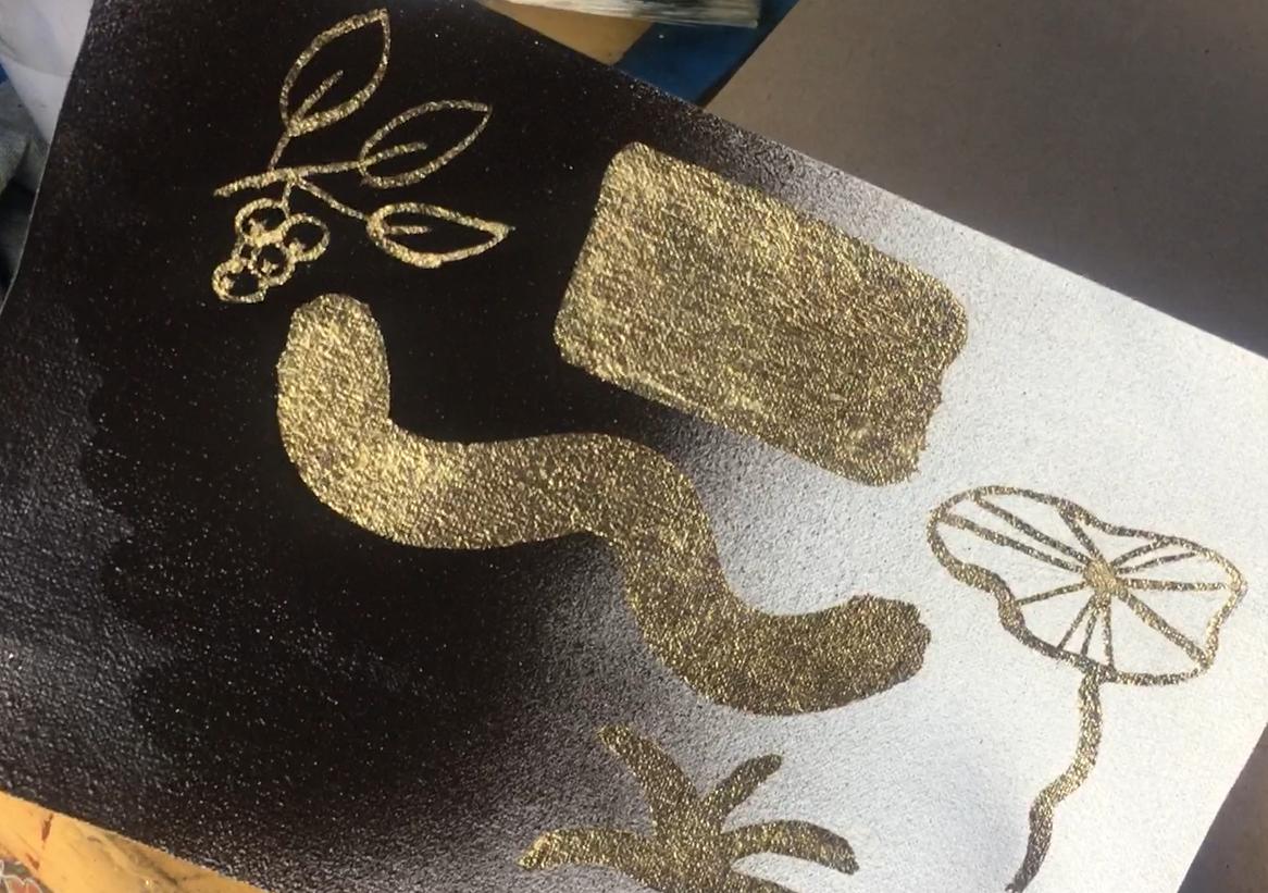 applying gold leaf