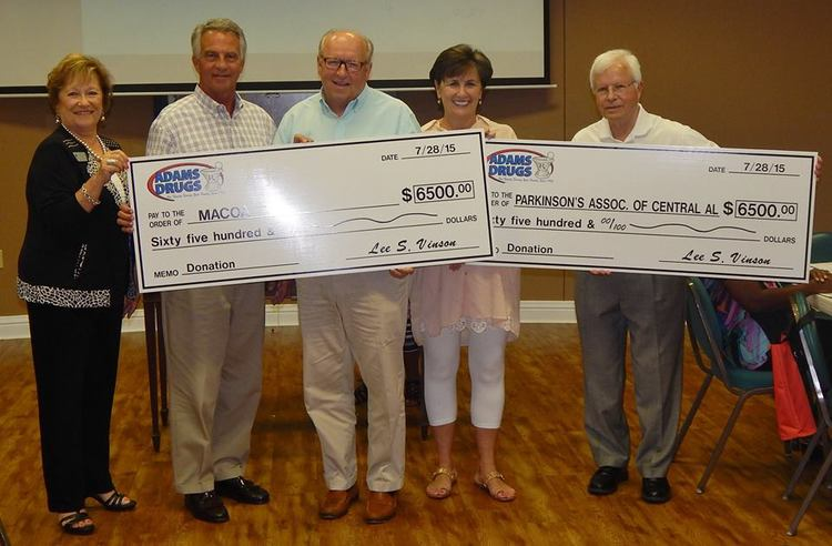 Donna Marietta, MACOA Executive Director, with Lee and Mike Vinson, Owners of Adams Drugs, Jim Smith, Marketing Director for Adams Drugs, and Doug Lindley, Board of Directors President of Parkinson's Association of Central Alabama, during a $6,500 check presentation to benefit both organizations