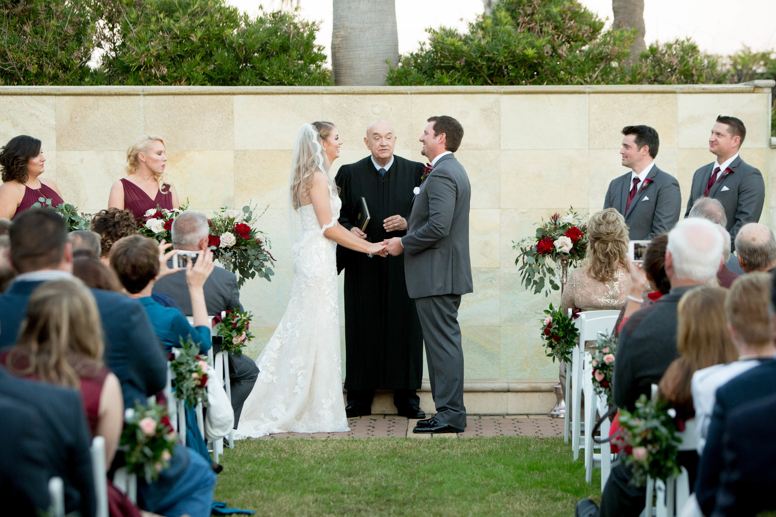 Outdoor Ceremony at Hotel Galvez | Burgundy winter wedding