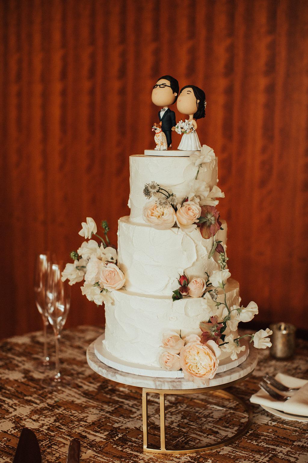 Buttercream cake with custom cake topper