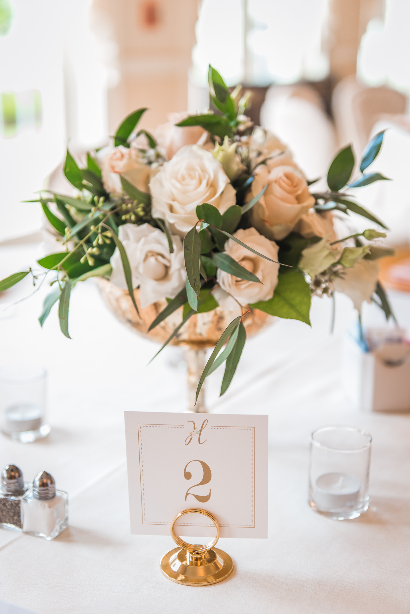 White and blush centerpieces with gold accents