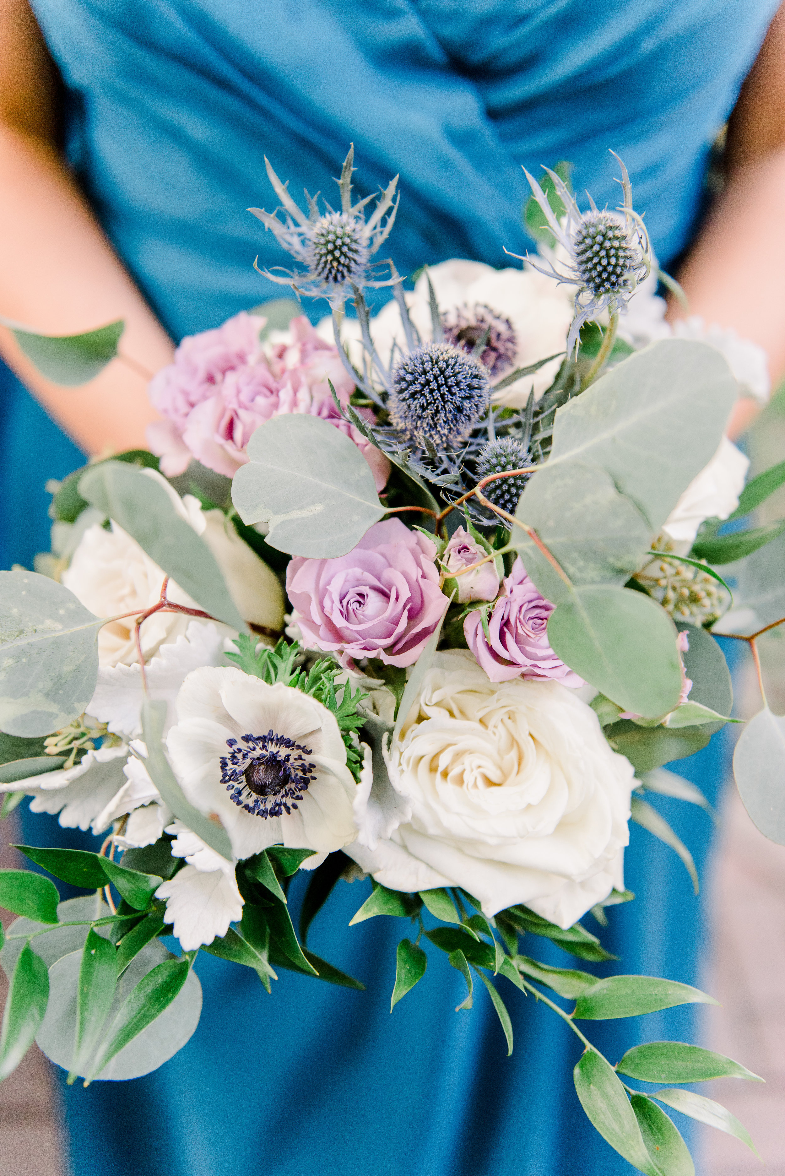 Blue, purple and ivory wedding bouquet