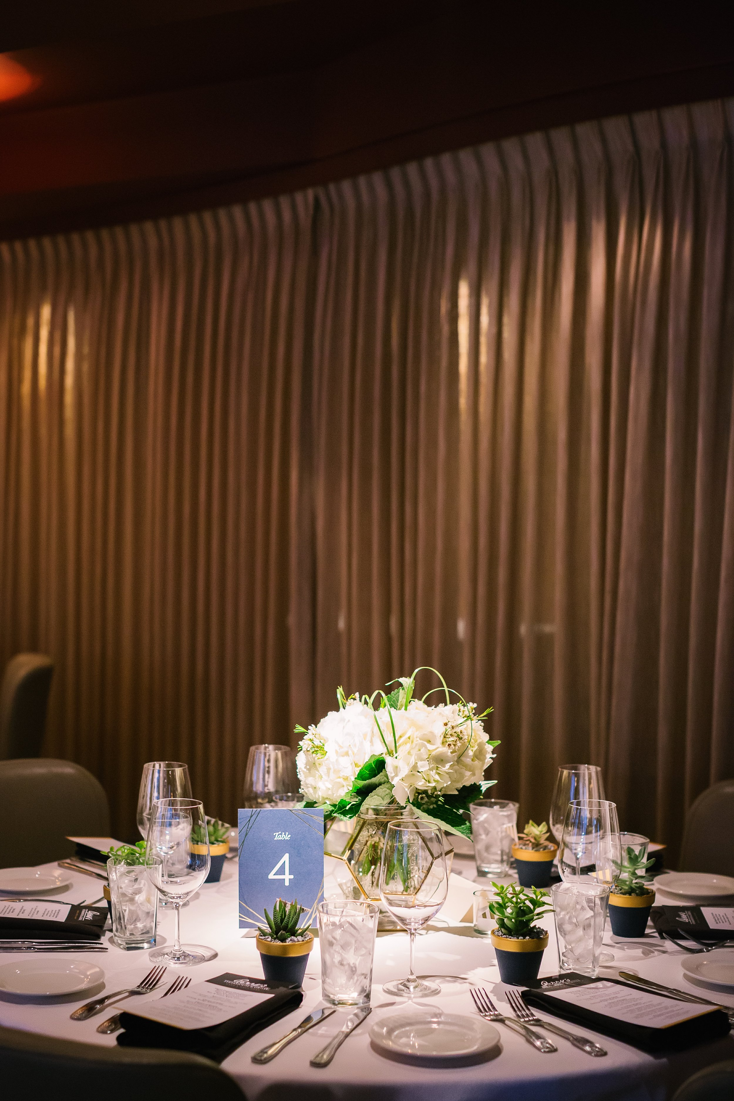 Succulent and Hydrangea centerpiece with geometric vases | Austin Weddings