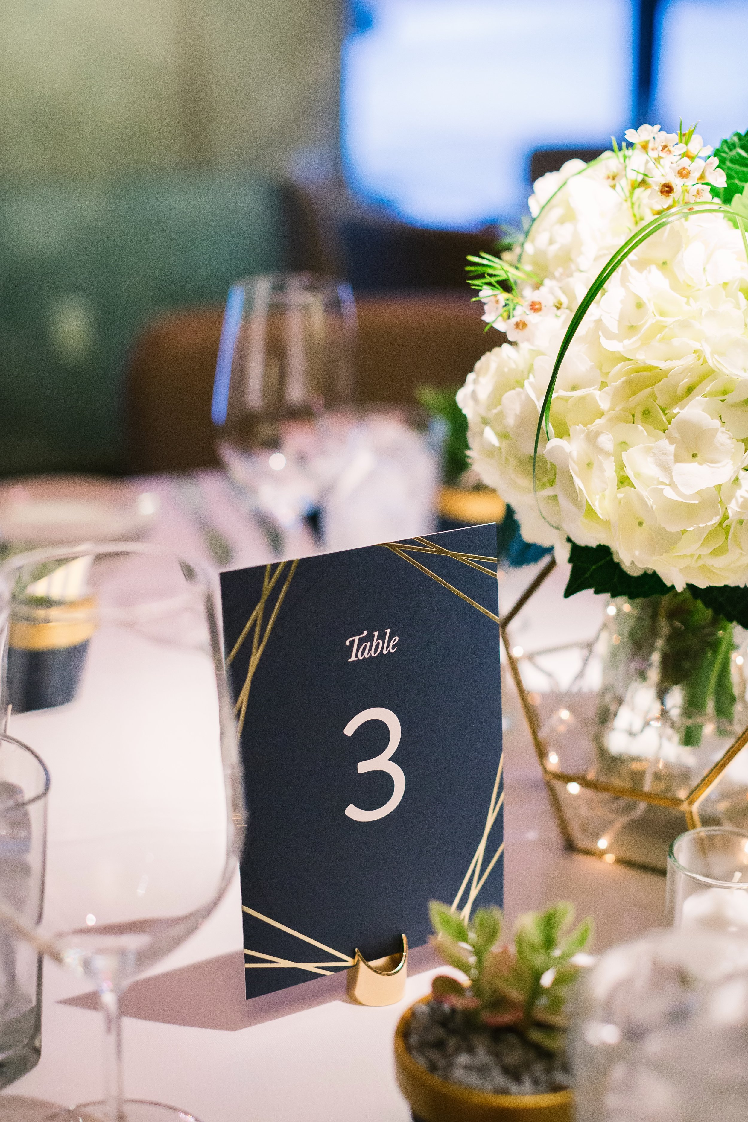 Navy and Gold Wedding | Hydrangea centerpieces with succulents