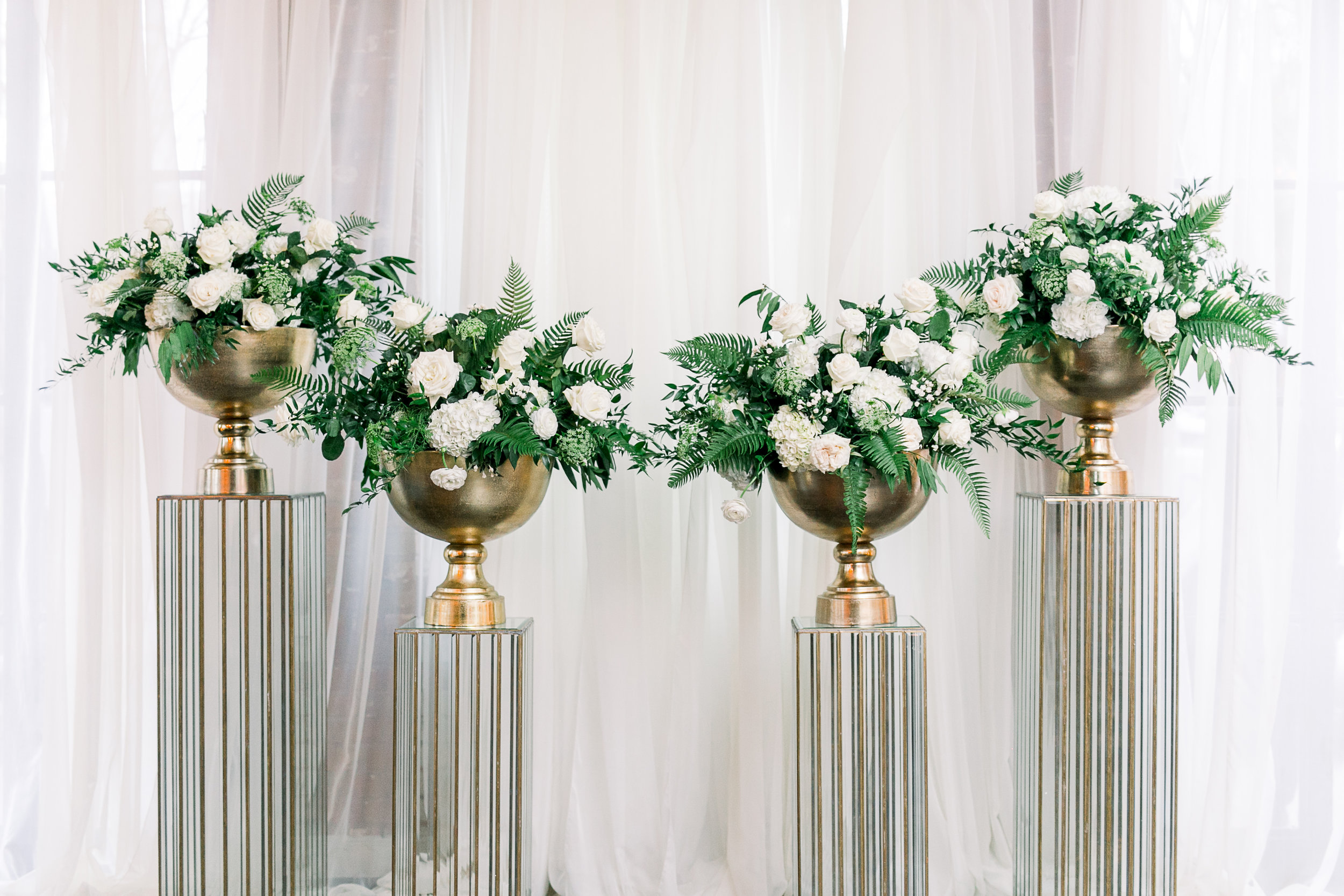 Station 3 Altar backdrop with four glass columns and white and green floral