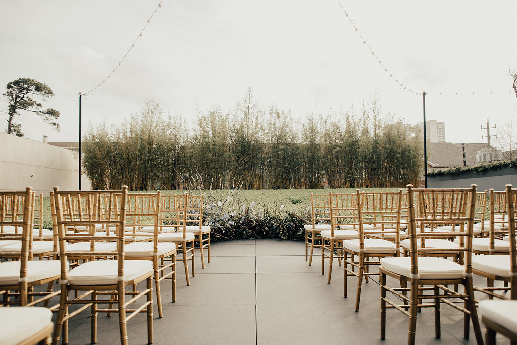 Curved ceremony chairs with a low altar arrangement