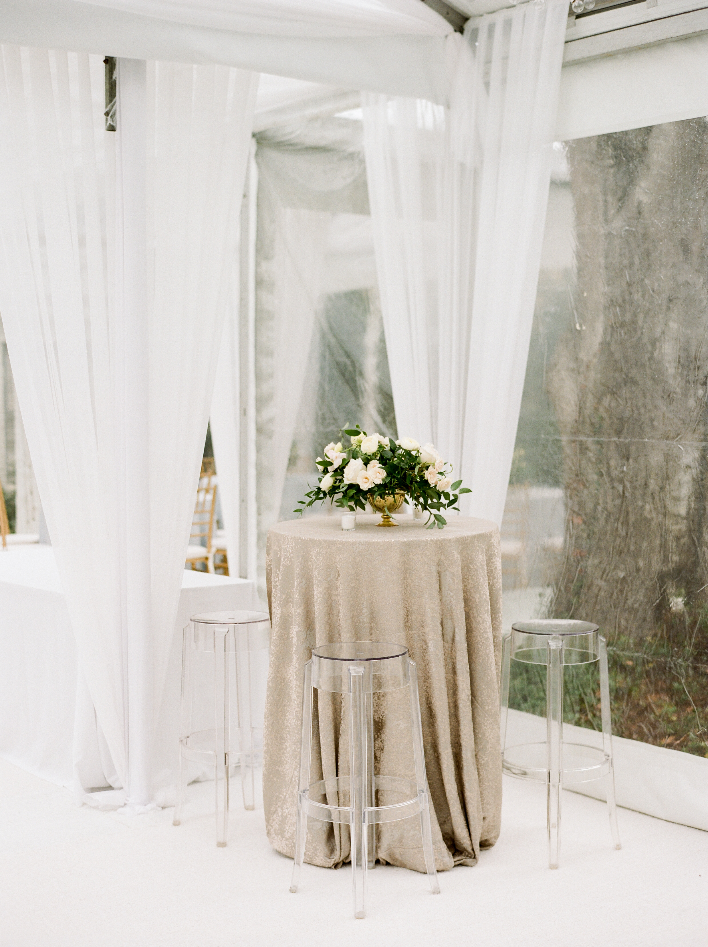 Clear top tent with draping and chandelier