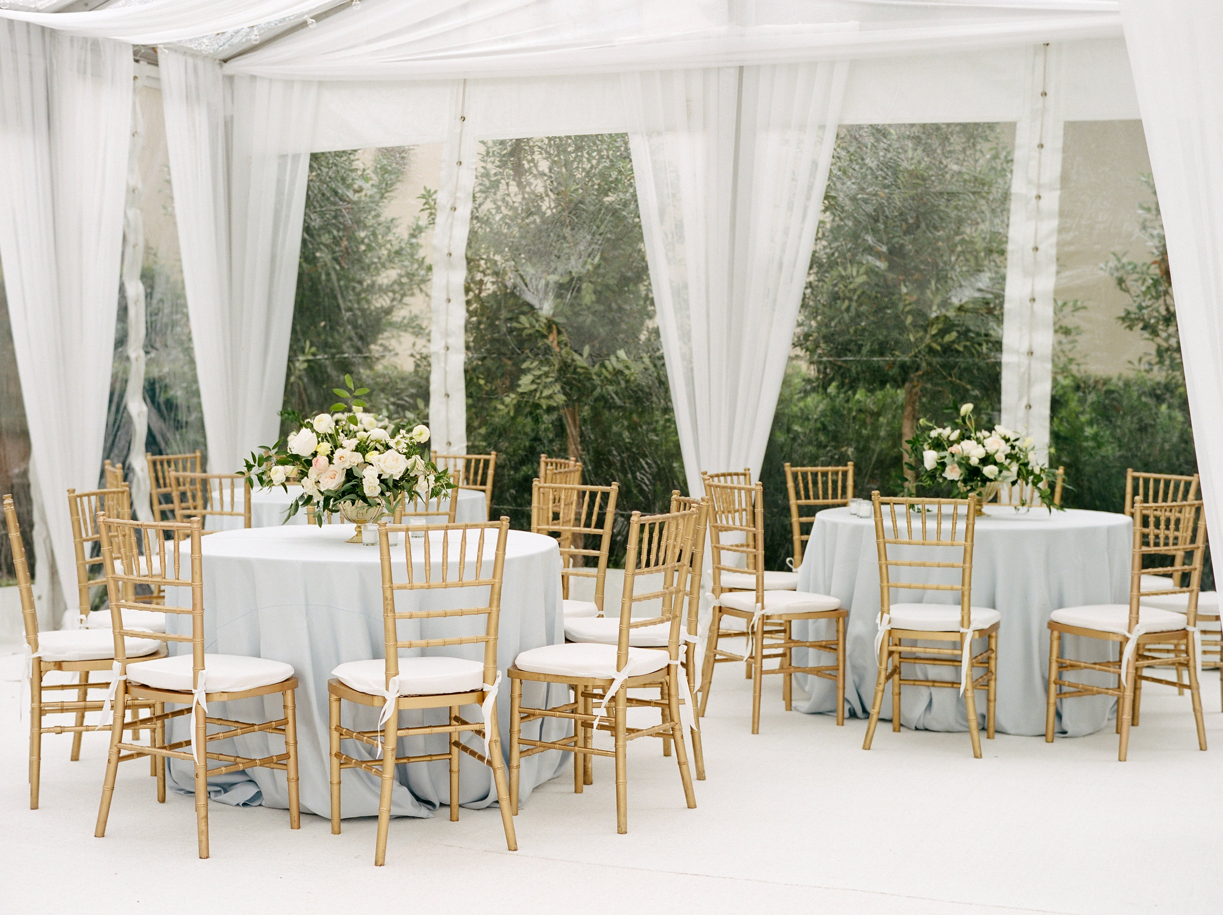 Clear top tent with draping and chandeliers | Houston Weddings