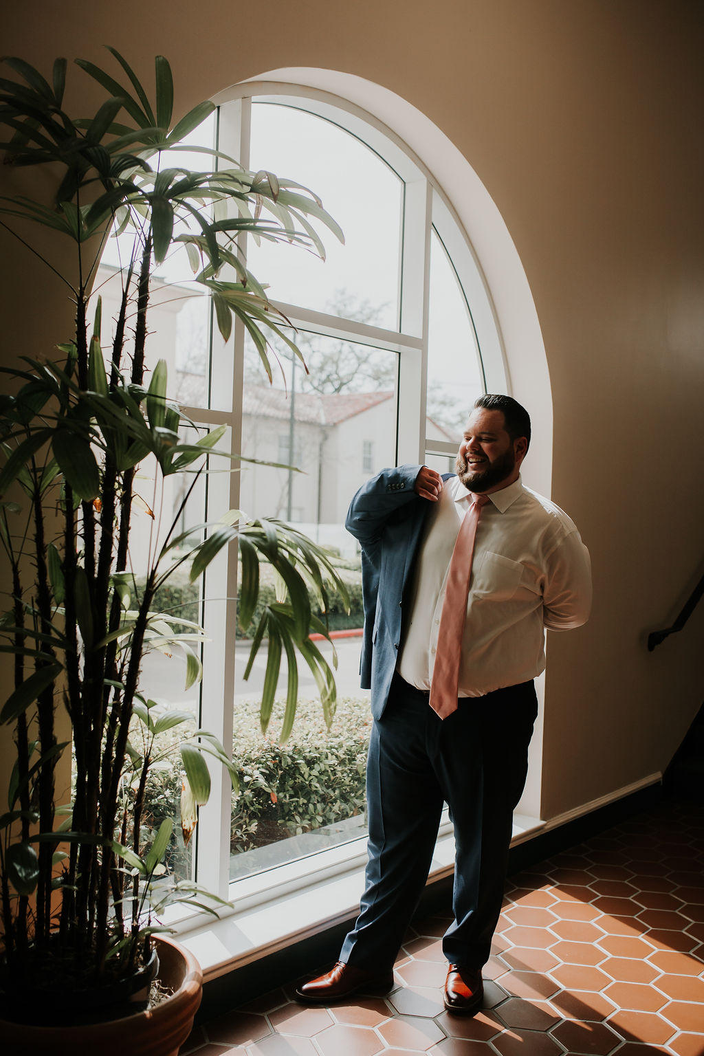 Groom getting ready with navy blue suit | Houston Weddings