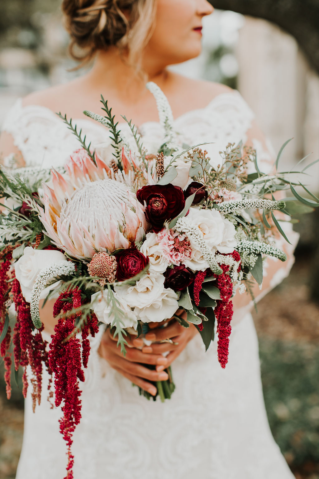 Beautiful bouquet hanging red amaranthus and blush pink and red flowers | Houston Weddings