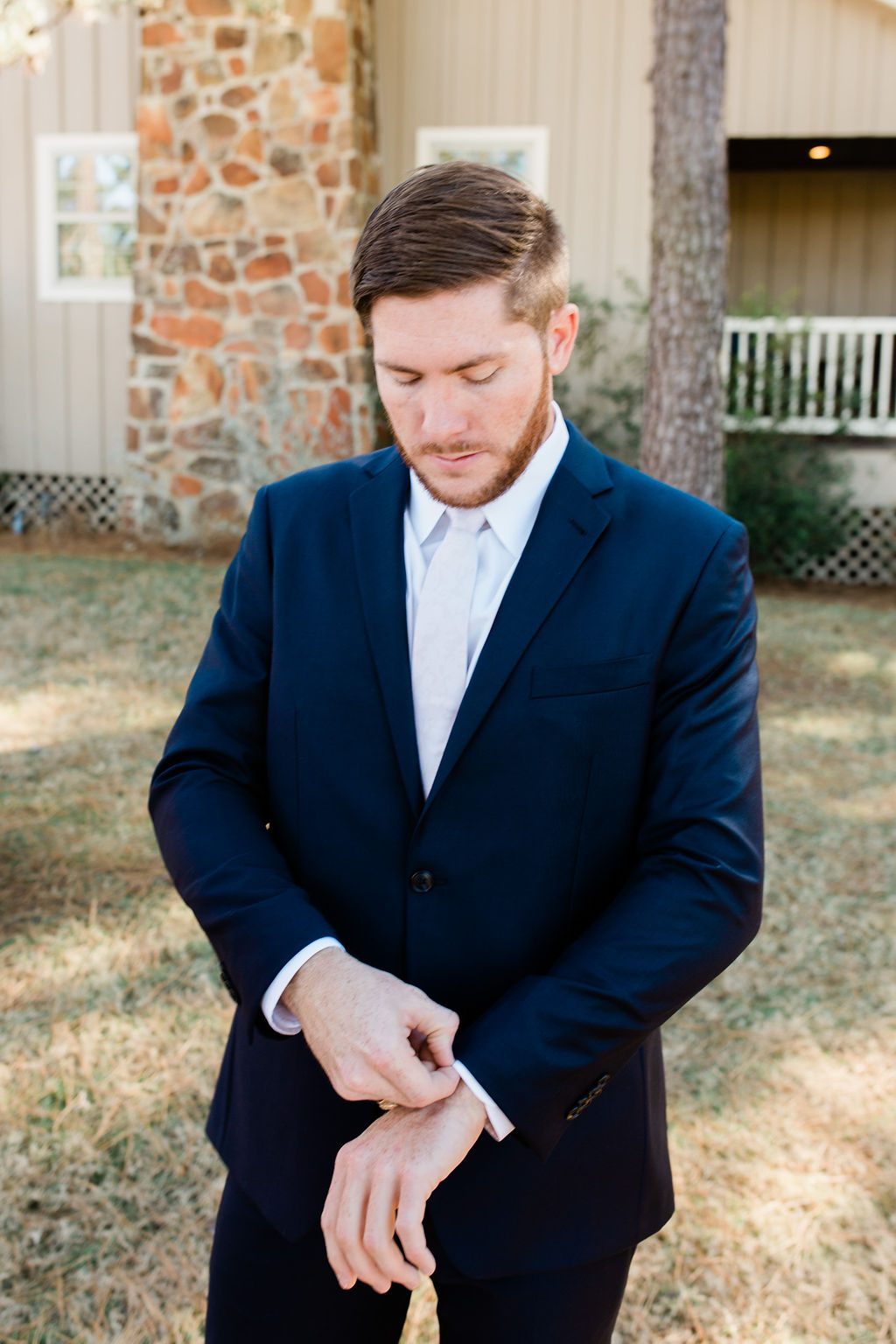 Groom with elegant navy blue suit | Houston Weddings