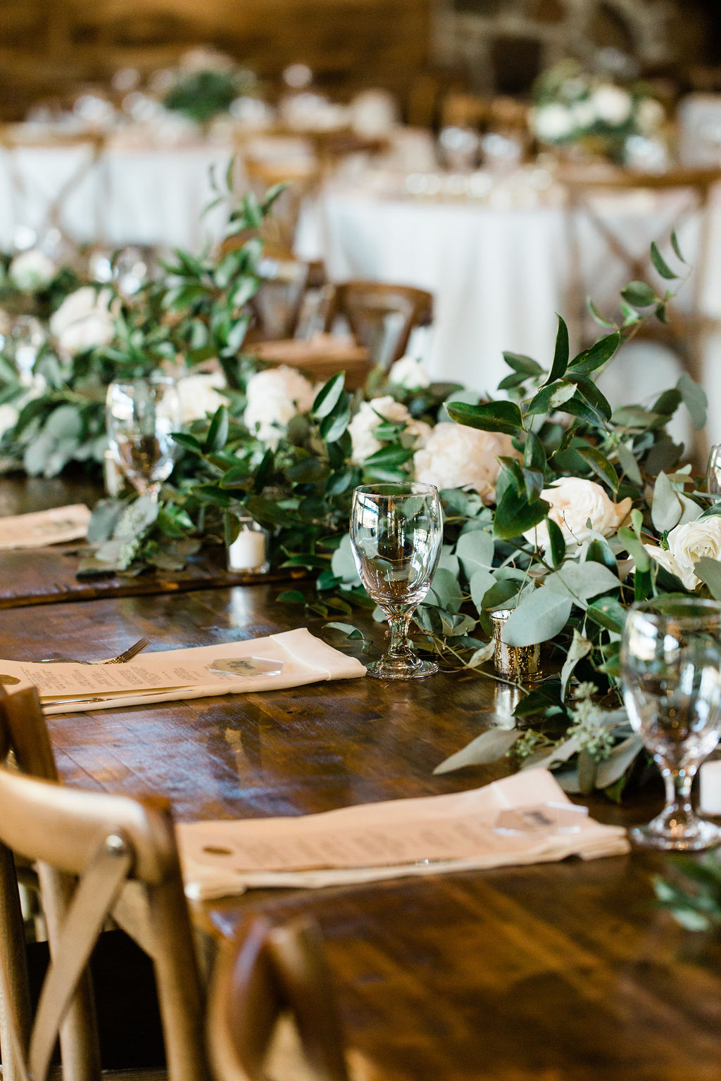 Greenery with white roses centerpieces | Houston Weddings