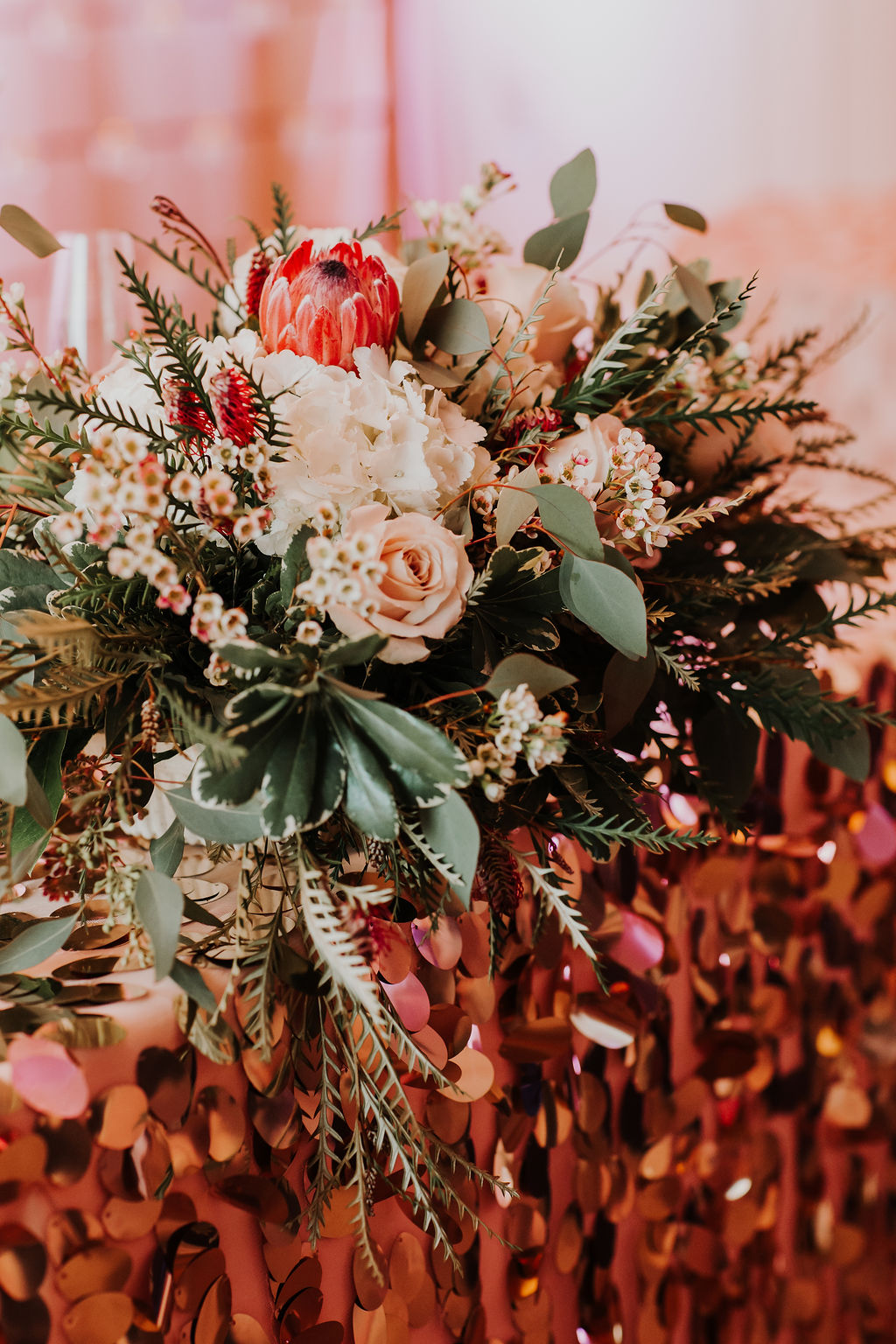 Floral with protea and greenery