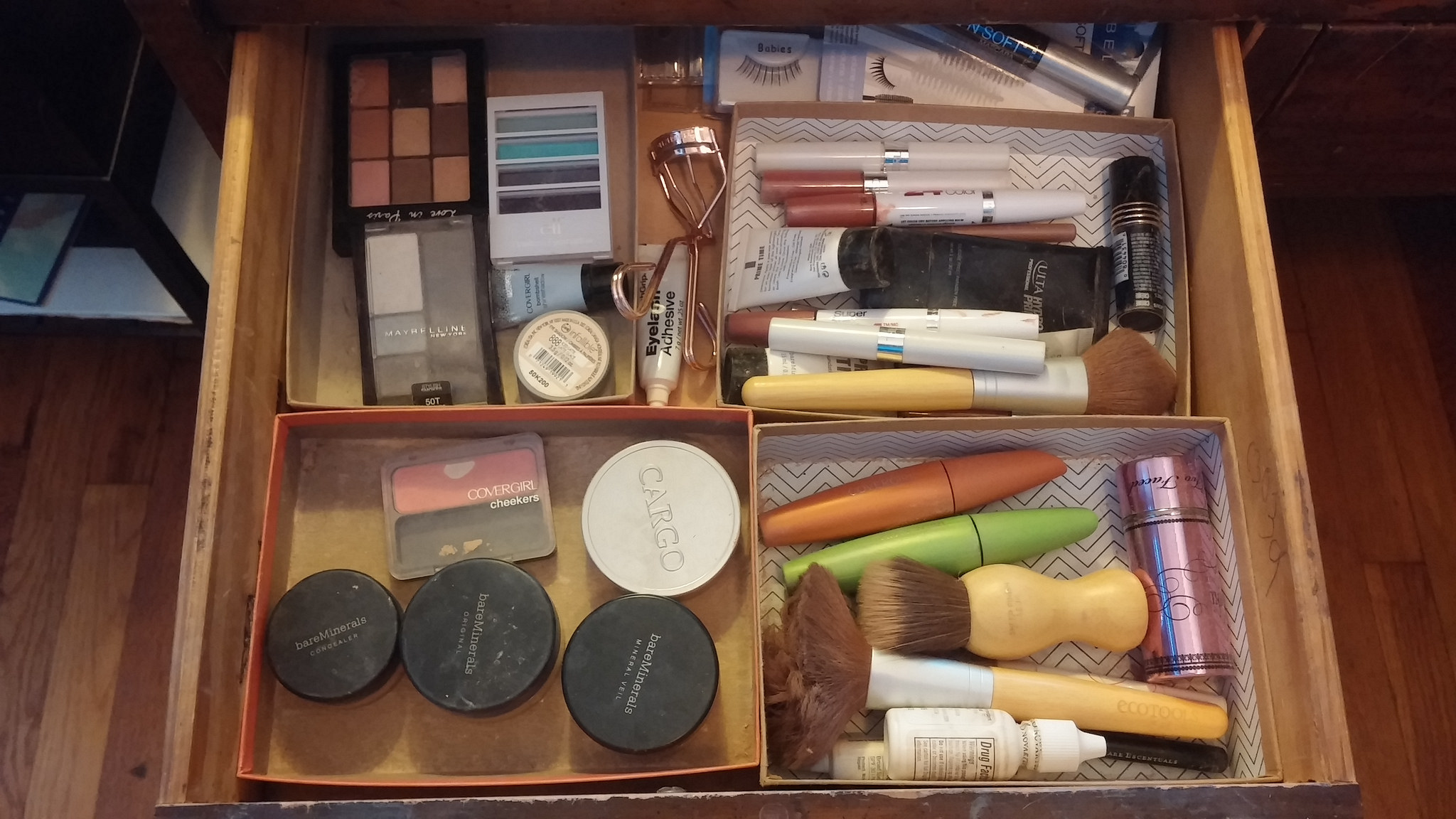My neglected makeup drawer, with my frugal cardboard box organizational system.