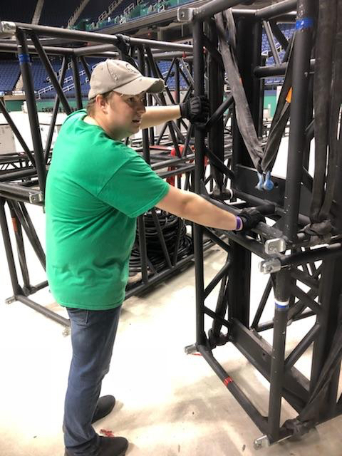 Josh Scovern working on the set of Marvel Universe LIVE! while wearing his Gig Gloves ONYX.