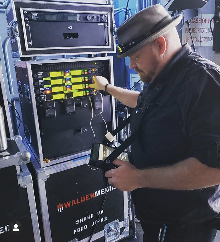 John Wolske, Henderson Pavillion Production Coordinator, at work dialing in wireless frequencies with his Two Hand Touch on hand.