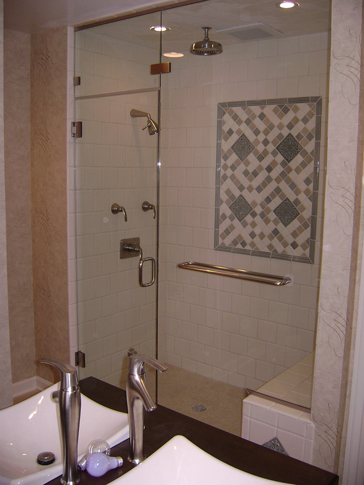 Custom euro door and panel steam enclosure with transom and towel bar