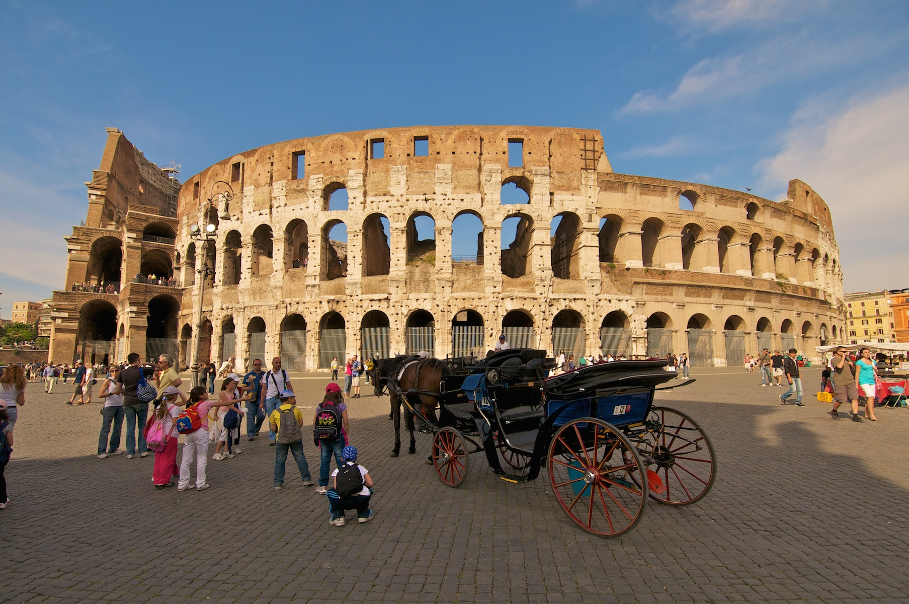Coliseum with tourist carriage