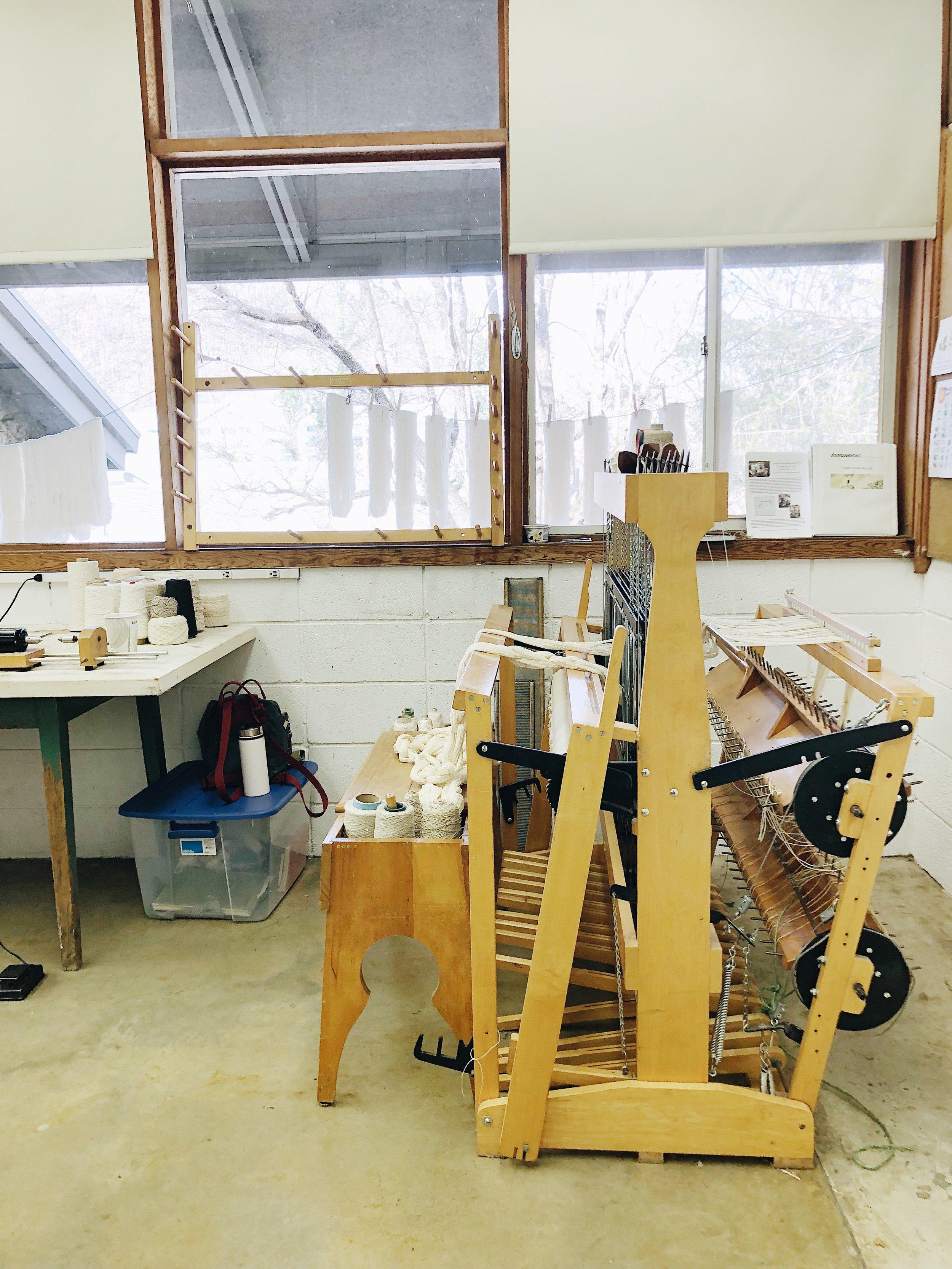 Weaving corner in the fiber studio.