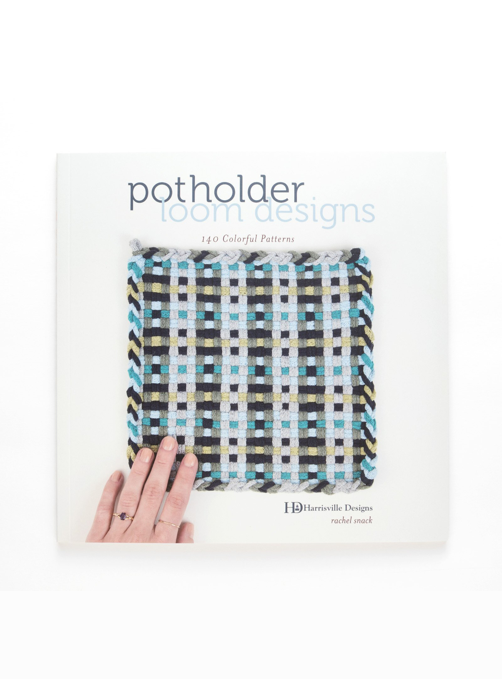 potholder loom designs: 140 colorful patterns   Unplug yourself—and any children in your life—and enjoy the art of weaving at the small-scale level with the fun, accessible potholder loom. Familiar to many from their childhood, simple square potholder looms hold stretchy fabric loops that are woven to create practical gifts or handy trivets for your own kitchen.