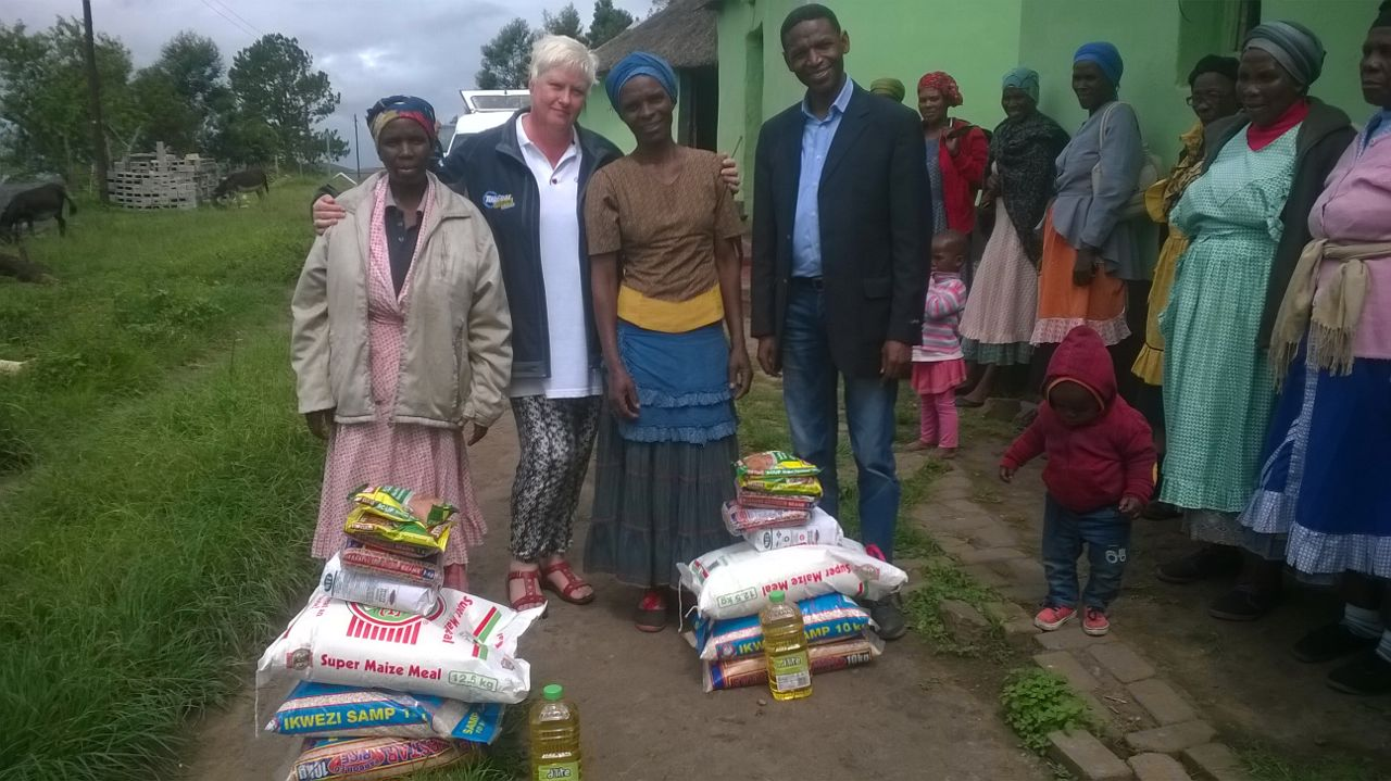 Our National Director Drina Engelbrecht with the new Eastern Cape Director Pastor Mbulelo Made delivering much needed food parcels. (5 Feb 2015)