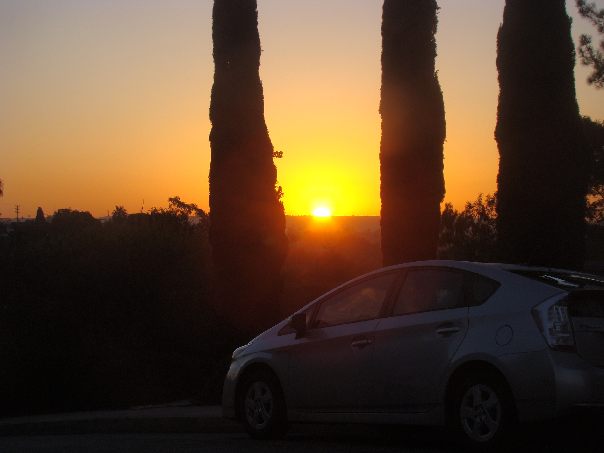 Sunrise over my Prius on Ashland at 14th in Santa Monica....    Never lose a Holy curiosity. Stop every day to understand and appreciate a little of the Mystery that surrounds you, and, your life will be filled with awe and discovery to the very end. …Albert Einstein
