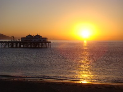 Sunrises under the watchful gaze of a sea bird at the Malibu Pier.   Know that your heart is a captive of a holy vision of that which is invisible. …Rev. Nancy Zala
