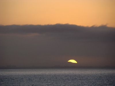 Sunrise surprises at Surfriders Beach in Malibu. Expected to have to wait for it to pop at the top of the cloud bank.   Whoever undertakes to set himself up as a judge of truth and knowledge is shipwrecked by the laughter of the gods. …Albert Einstein