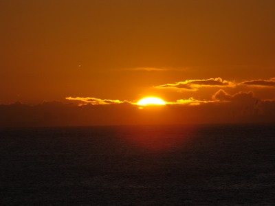 Sunrise plunges upward through the remaining clouds in Malibu.   True perfection has space for imperfection. … Alan Cohen