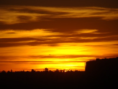 Sunrise in Santa Monica barely breaks the horizon as a jet comes in to land at distant LAX.   When people start focusing on what they want, what they don't want disappears. ...Jack Canfield