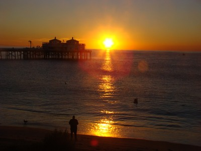 Sunrise over a pair of pelicans and a photographer trying to catch a photo of them at Surfriders beach at the Malibu Pier.  Anyone who has never made a mistake has never tried anything new. …Albert Einstein