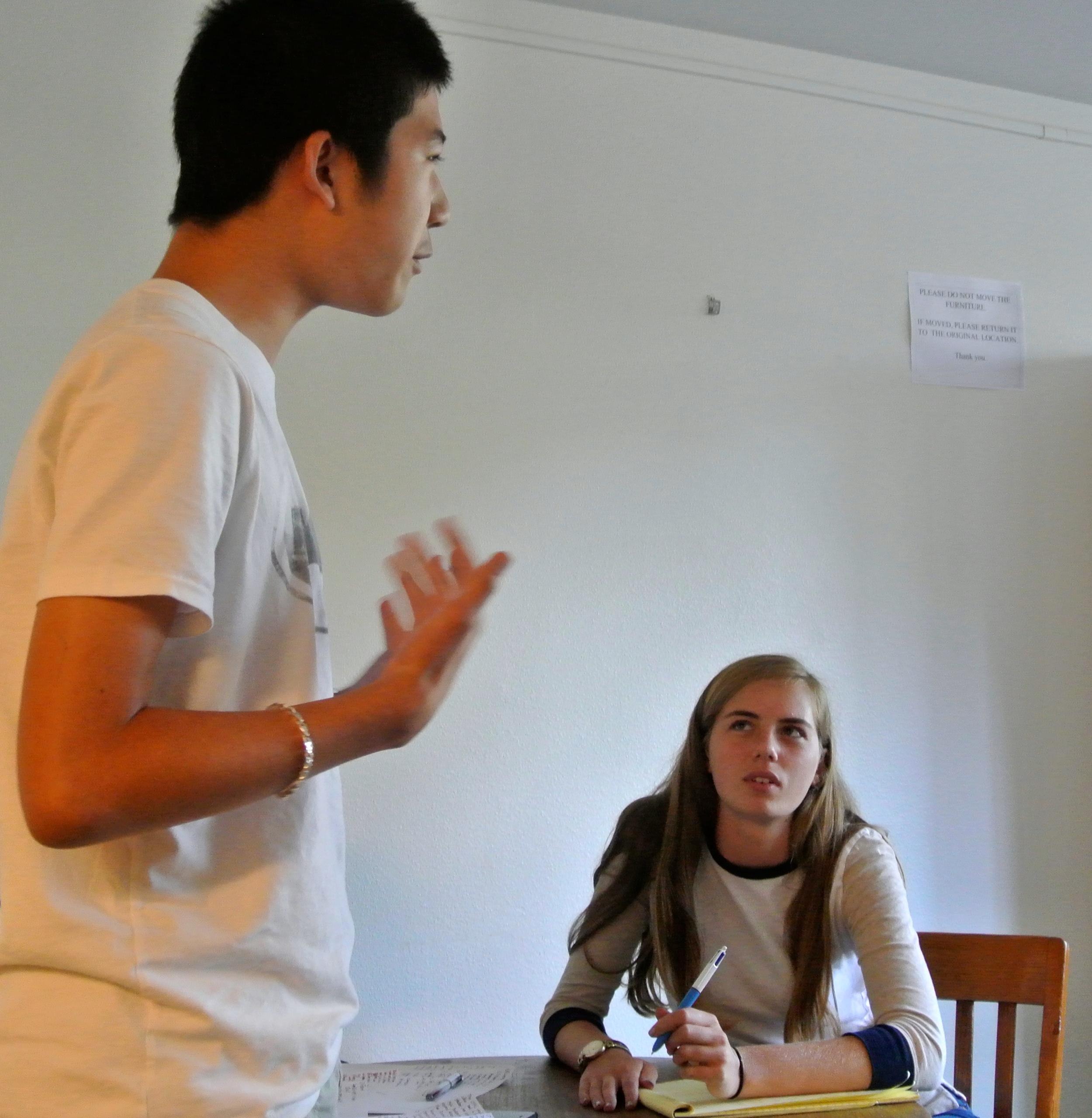 Dougherty Valley's Edward Yu debates as judge Nadia Perl looks on.