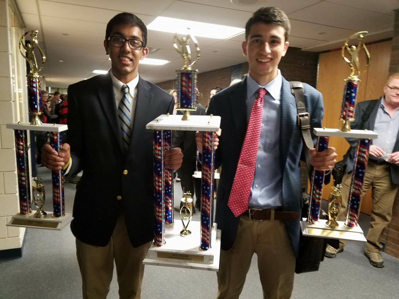 Ridgefield's Will Barth & Kunal Chauhan pose with trophies.