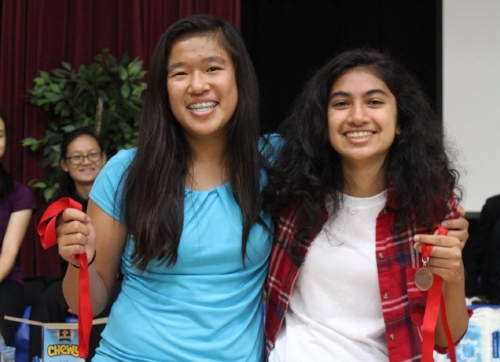 The novice top-seeded team of Ananya Thapur & Madeleine Wong poses with medals.